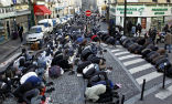 Image of Muslims take over a Parisian street for prayers.