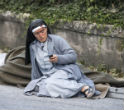 Image of A nun rests after escaping the quake.
