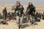 Image of U.S. soldiers providing training to Afghani personnel.