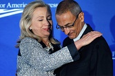 Image of Hillary Clinton (now the Democratic nominee) and John Podesta