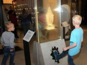 Image of The exhibit, which attracts children, encourages people to desecrate a statue of the Virgin Mary.