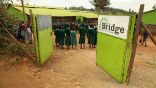 Image of Students attend a Bridge Academy in Africa. Uganda has ordered the closure of these schools.