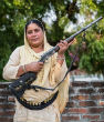 Image of Shahana Begum protects women with her shotgun and as a result, violence against women has dropped dramatically.