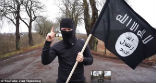 Image of Dressed a a terrorist and carrying a fake gun and ISIS flag, Vlad Tapes exposes a glaring hole in European border security.
