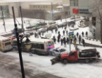 Image of Freezing conditions in Montreal caused two buses, a police car and a snowplow to pile up in a downtown intersection.