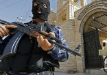 Image of ISIS terrorists take over a Christian church in Mosul.