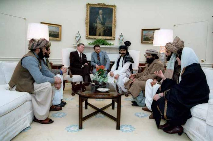 President Reagan meets with Mujaheddin fighters in 1985. Al Qaeda was spawned from this alliance.