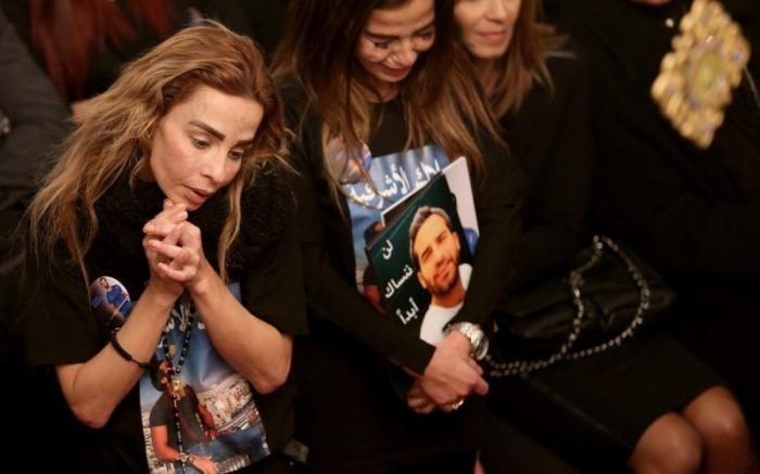Sisters of Elias Wardini, a Lebanese man killed in a gun attack on the Reina nightclub in Istanbul, mourn during his funeral Mass at the Church of Our Lady in Beirut.
