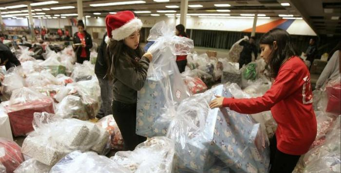 Students working with toy donations during Christmas