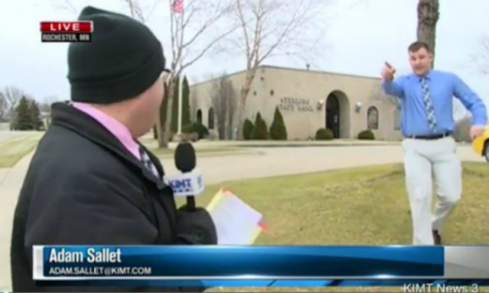 Bank employee tells news reporter Adam Sallet that a bank robber had returned to the scene of the crime.