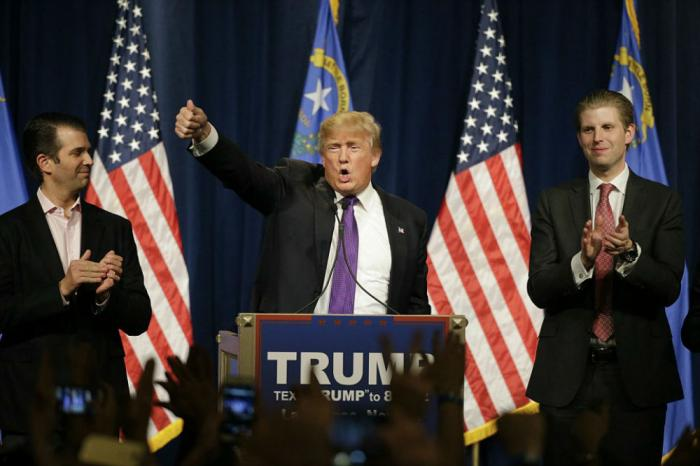 Donald Trump stands with his sons Don Jr. and Eric to deliver his victory speech.