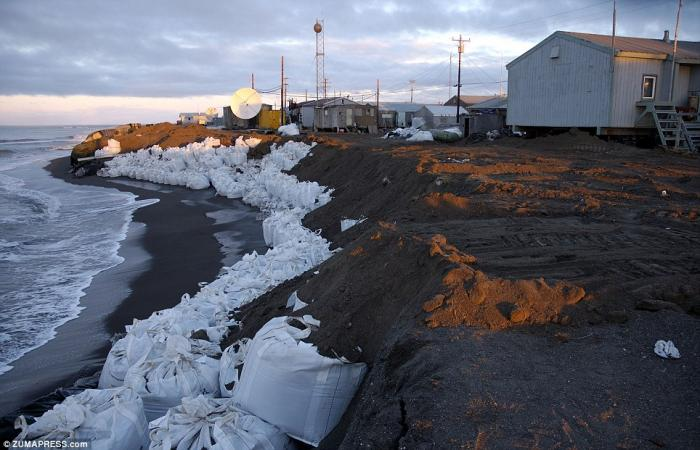 An Inuit village must now rely on sandbags to prevent erosion of their island home. For hundreds of years, until now, ice provided the protection they needed.