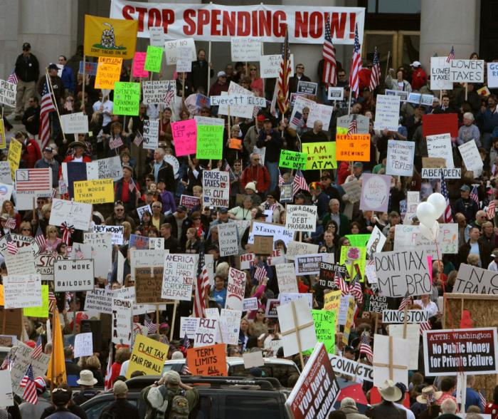 Protesters call for the IRS to stop political profiling.