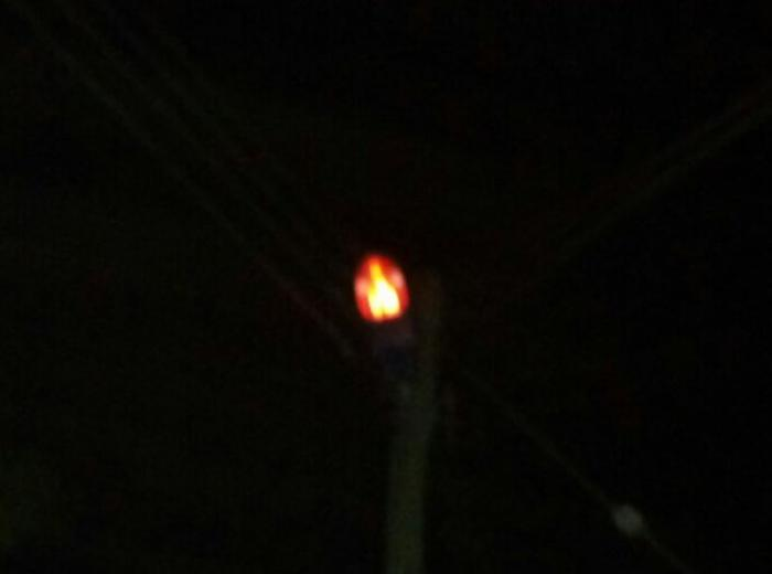The apparition comes from a light bulb. No other image can be seen in any of the city