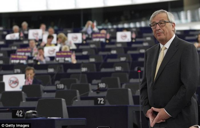 Jean-Claude Juncker, President of the European Commission is seen making the sign.