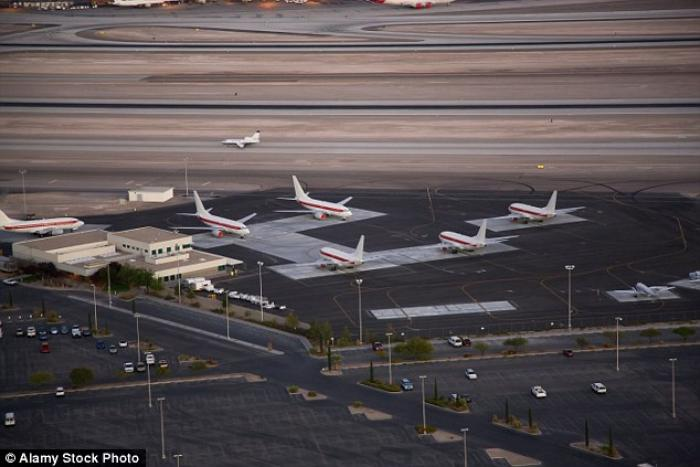 The unmarked planes are parked at a secluded terminal at McCarran International Airport.