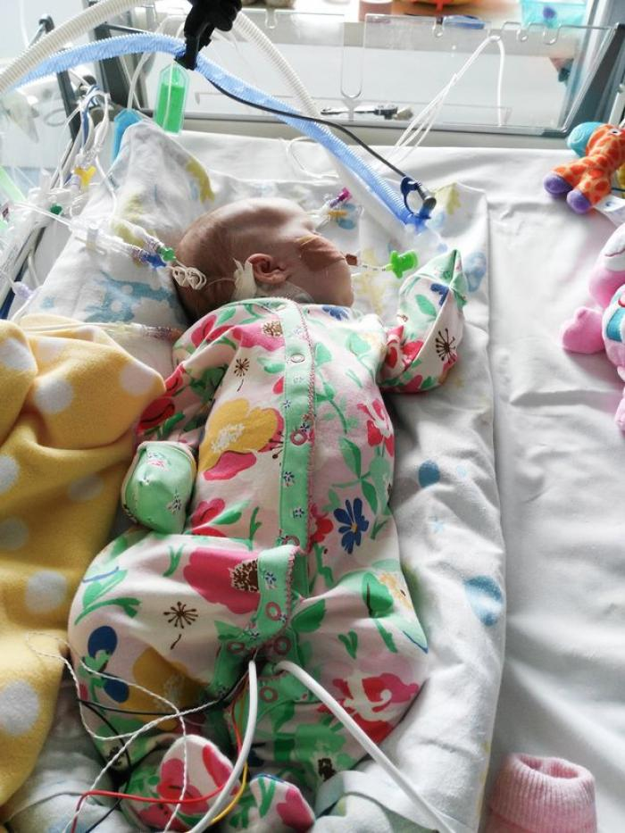 Baby Caitlin improved after her parents placed an original relic of St. Padre Pio in her bed.
