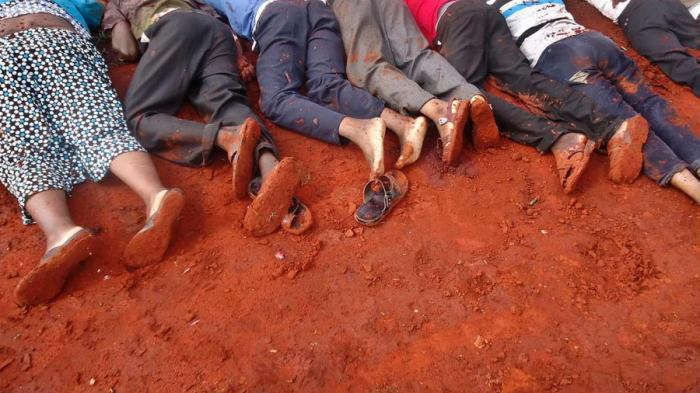 The bodies of some victims were lined up in the dirt.