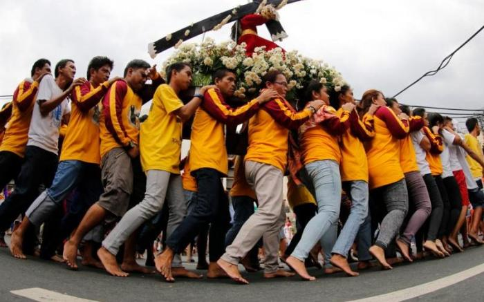 Catholics carry a replica of the Black Nazarene during a procession ahead of feast day celebrations in Manila.