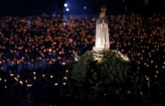 A statue of Our Lady of Fatima is carried through the crowd May 12 at the Marian shrine of Fatima in central Portugal.