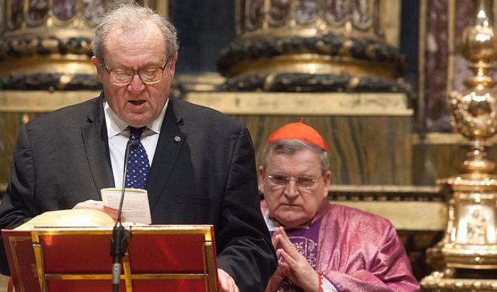 Grand Chancellor Michael Festing reads from the Bible as Cardinal Raymond Burke looks on. Cardinal Burke is Pope Francis' representative to the order.