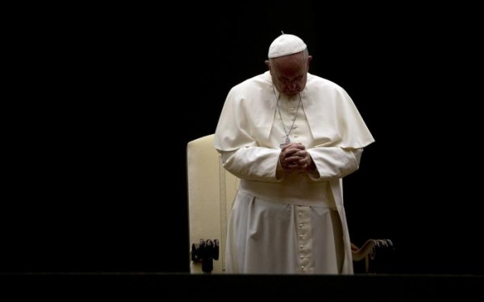 Pope Francis prays at St. Peter's Square.