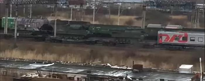 A video purports to show Russian military equipment on one of three trains headed to the border.