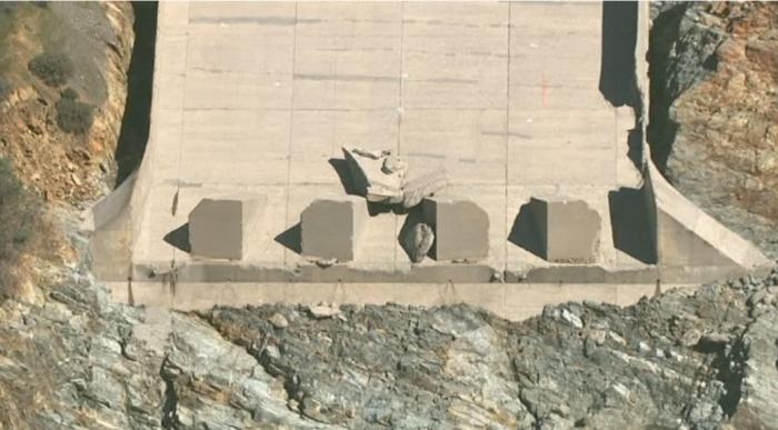 Fig 15. Large Block of concrete at the end of the spillway after the blowout failure. Block originated near (just above) the blowout failure critical seam. Shadow reveals the significance of the thickness of this block.