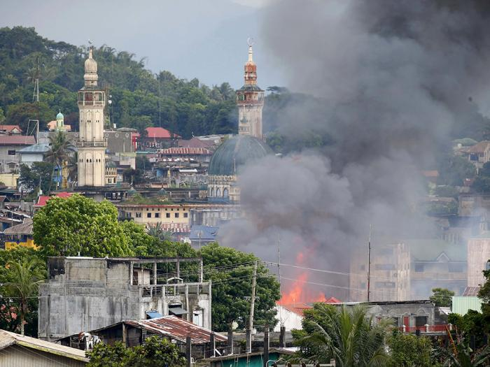 A structure that was once a strongpoint for terrorists burns in Marawi following an airstrike. The military continues to crush the terrorists, although slowly and methodically.
