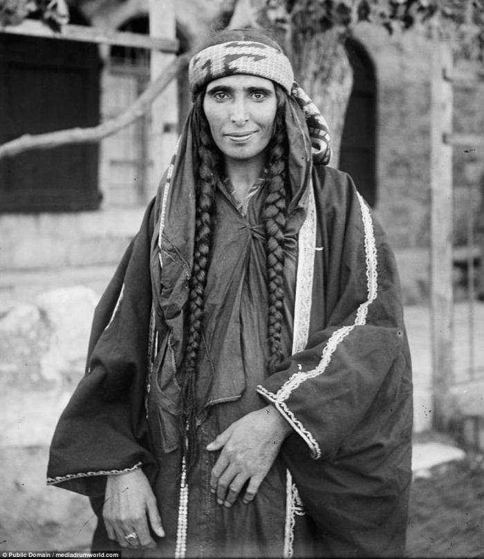 A Bedouin woman in traditional dress. This photo, as well as the others in this series was taken between 1890 and 1914.