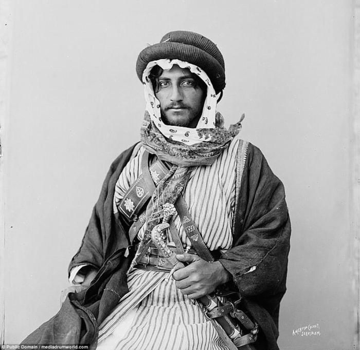 A young Bedouin man poses for the camera. The Bedouin still live from North Africa to the Middle East, but move less freely in the modern world.