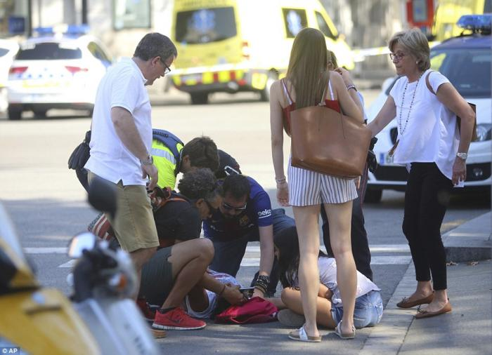 Bystanders rush to aid the injured.
