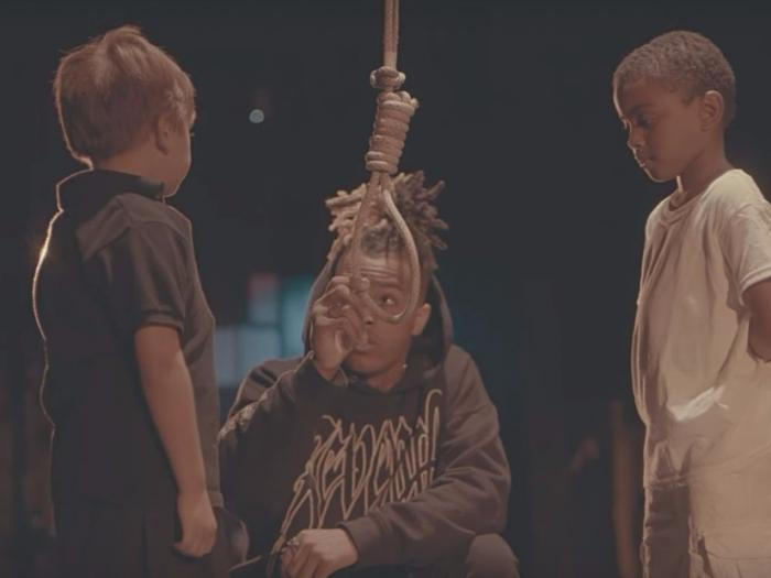 Rapper XXXTentacion lynches a child in his video.