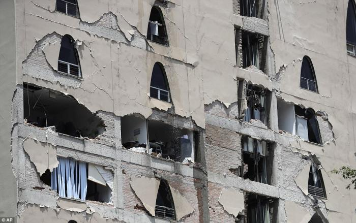 Shaking caused the facades of several buildings to fall away, exposing their interiors to the outside.