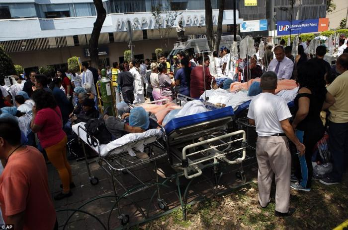 Hospitals evacuated patients to the outdoors and tended to them there as fear of further aftershocks and collapses worried officials.