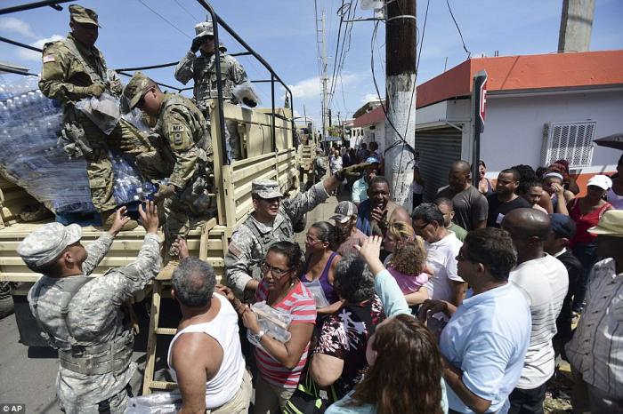 The National Guard has arrived to deliver food and water to the people.