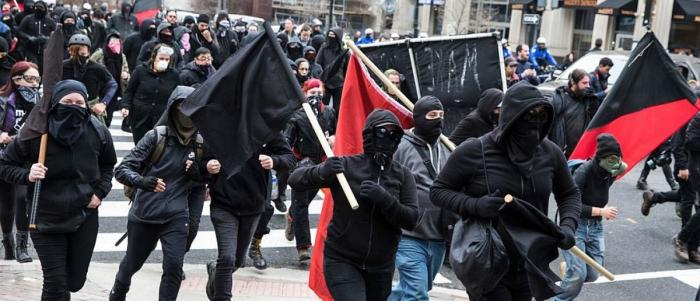 ANTIFA runs riot during a protest. The foot soldiers remain anonymous and have one aim, which is violence.