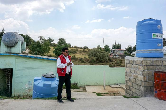 Ernesto Flores Martinez, the school's principal, says access to water would improve if the school paid to tap into a local reservoir. But he's hesitant to pass on yet another cost to parents.
