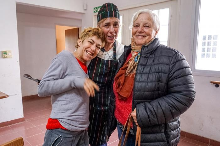 Graciela Ferrari (left) regularly visits Centro de Dia, a center run by local nonprofit Fundacion IPNA. She has befriended Sonia Trabichet (center), a cook, and comes to the center with her mother, Beatriz Rueco (right).
