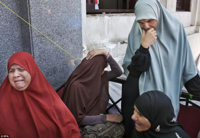 Relatives mourning outside a field hospital at Rabaa Adawiya mosque on Saturday.