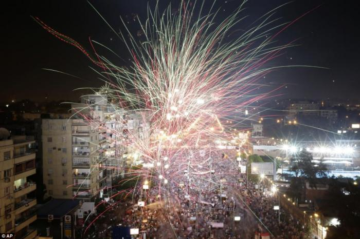 Fireworks were let off above the crowds at the presidential palace in Cairo.
