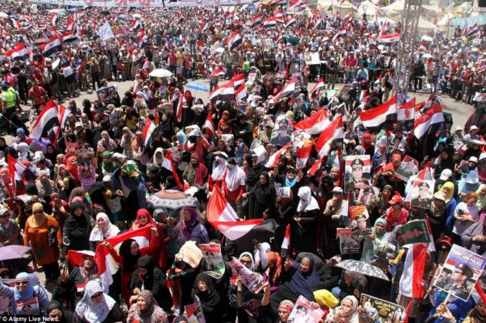 Both the army and the ousted president have thousands of supporters in Egypt.