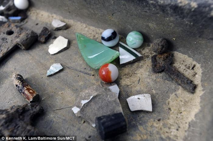 Marbles,a key, and other artifacts reveal something of everyday life in the settlement.