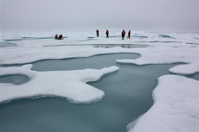 A research team tries to navigate the ice ponds of the arctic, which are common during the short arc