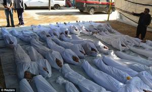 Bodies laid in rows for identification before burial.
