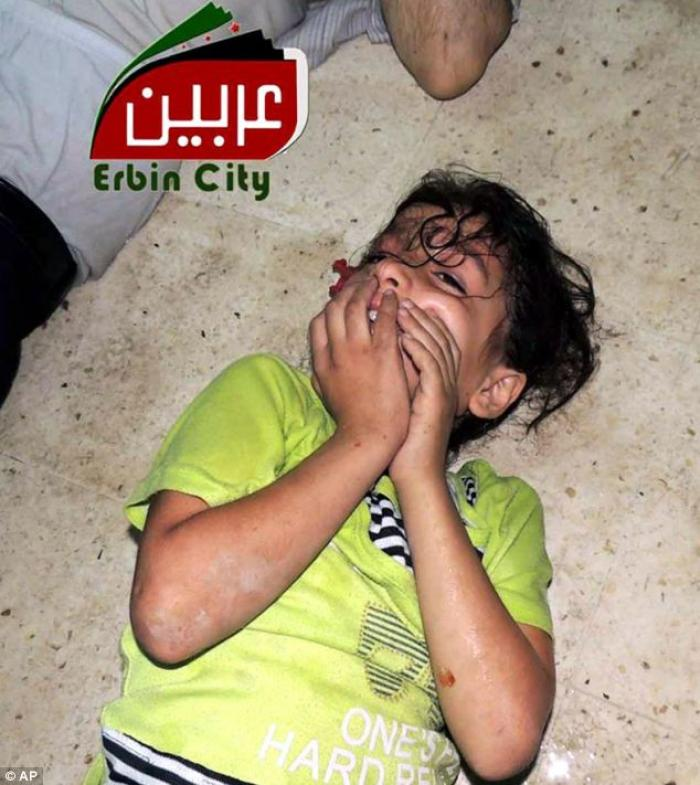 A child suffering without even a bed to lie on. Hundreds of children died in the early morning attac
