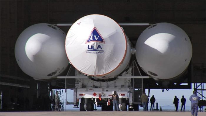 The Delta IV being rolled out to the launch pad. This image helps covey its massive size.
