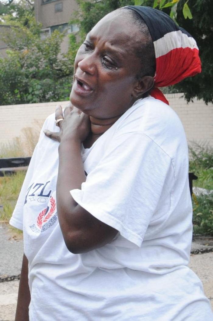 Cheryl Steele, The Great Aunt of shooting victim 1-year-old Antiq Hennis, cries on the corner of Bri