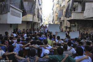 Mourners unite at a Syrian Free Army symbolic funeral held in Aleppo today as rebel brigades continu