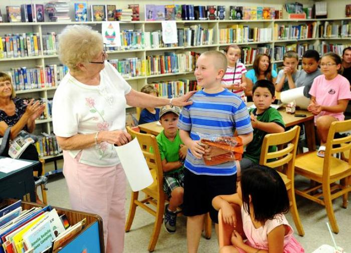 Can a child -- read too much? A library in upstate New York thought so, dismissing a faithful employ